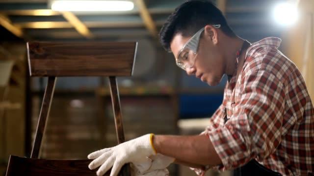 Carpenter inspecting wood job