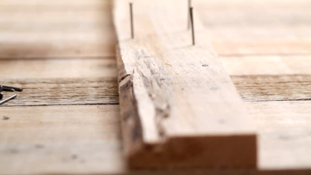 Carpenter nailing planks video