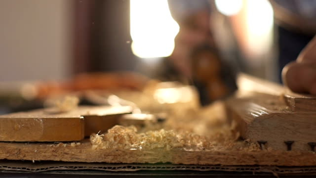 Carpenter planed wood, workplace. Slow motion video