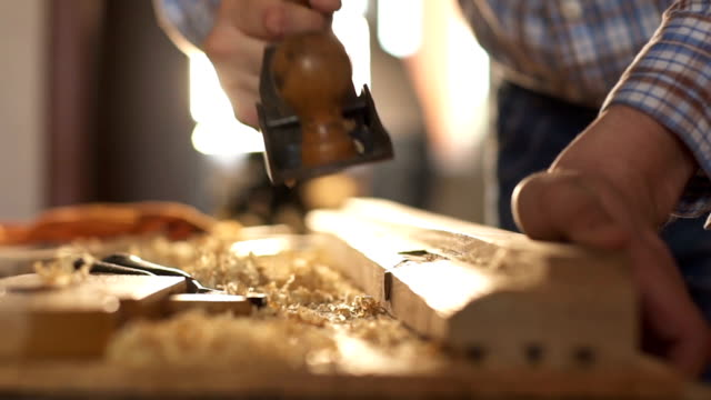 Carpenter planed wood, workplace. Slow motion Carpenter planed wood, workplace. Slow motion workbench stock videos & royalty-free footage