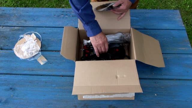 Carpenter unpacking circular saw