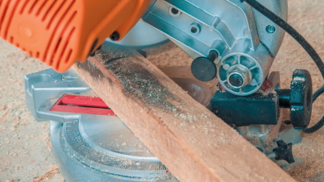 Carpenter Using Circular Saw for Cutting Wooden Boards Carpenter using circular saw for cutting wooden boards. Construction details of male worker or handy man with power tools power tool stock videos & royalty-free footage