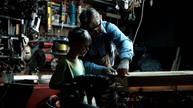 Carpenter with grandson making window video
