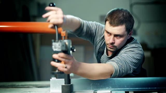 Carpenter working in studio video