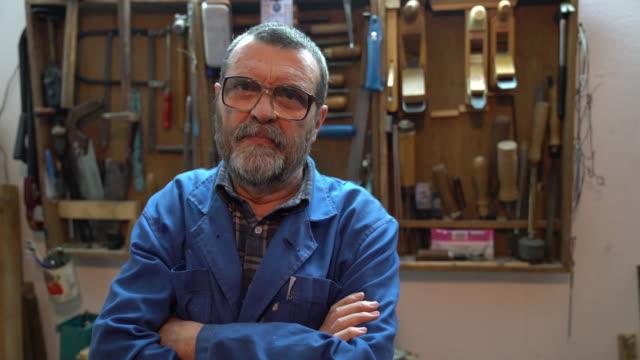Carpenter working in the garage video
