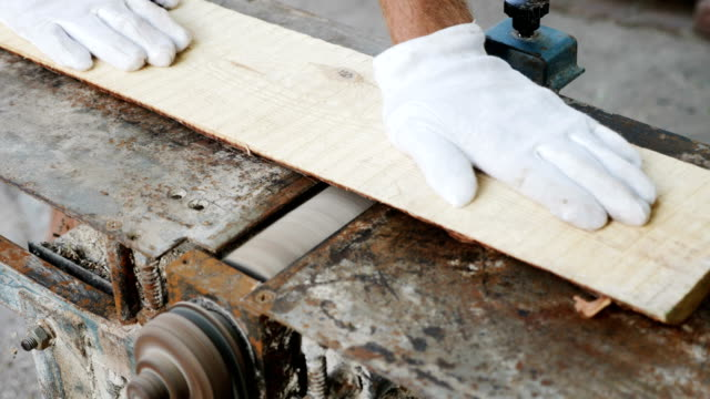 Carpenter working with electric planer on plank video