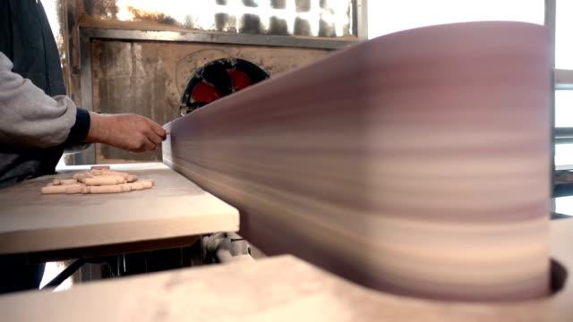 Carpenter Working With Sandpaper Polishing Machine