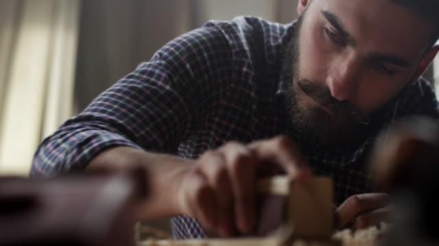 Carpenter working with sandpaper