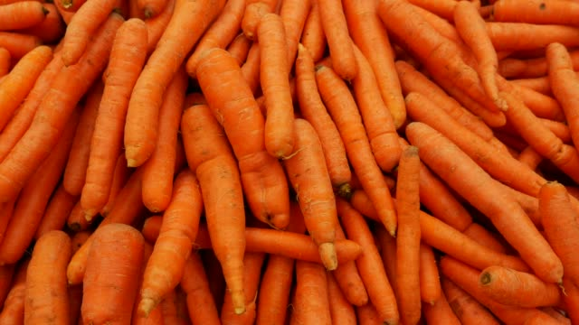 Carrot at Farmer's Market Carrot at Farmer's Market carrot stock videos & royalty-free footage