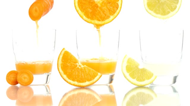 carrot orange lemon juice vitamin a c e - vitamin d stok videoları ve detay görüntü çekimi