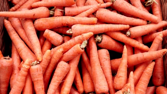carrot vegetables background, local produce market. Local produce carrots are displayed for sale at the market. Organic and bio fresh healthy eating concept. carrot stock videos & royalty-free footage