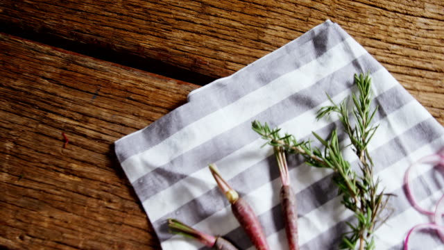 Carrots, rosemary and onion rings on napkin 4k High angle view of carrots, rosemary and onion rings on napkin 4k onion ring stock videos & royalty-free footage