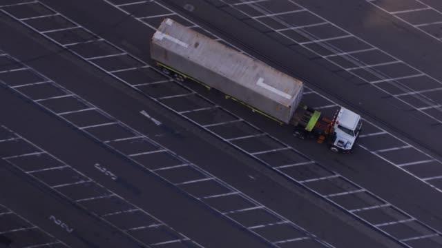 UTR Carrying Cargo Container Through Shipping Terminal - Drone Shot – film