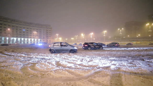 Cars drifting in the winter in a public parking. video