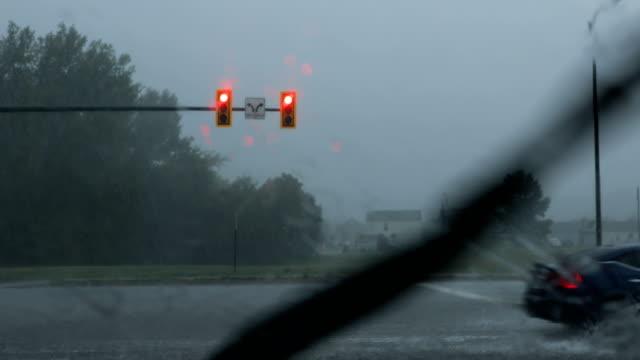 POV Cars Driving in Heavy Rain at Traffic Signal