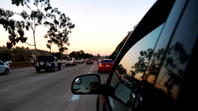 cars driving in traffic jam on 5 highway in california in slow motion - rideshare stock videos and b-roll footage