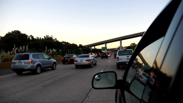 Cars driving in traffic jam on highway in California in slow motion