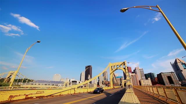 cars driving on yellow bridge to downtown cityscape - solar panel bildbanksvideor och videomaterial från bakom kulisserna