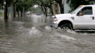 istock Cars driving through a flooded intersection during a flooding event in NOLA 1201439037