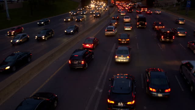 HYPERLAPSE Cars entering a busy jammed freeway highway in the evening rush hour