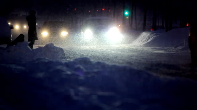 Cars in snowstorm video