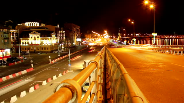 Cars night traffic time-lapse on bridge road junction urban city video