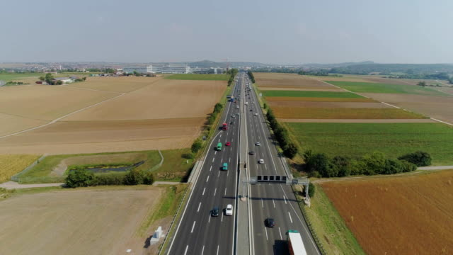 cars on the autobahn in germany fast driving beautiful road - autobahn video stock e b–roll