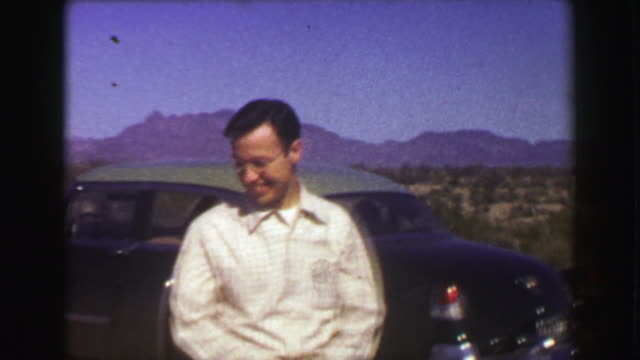 1951: Cars parked at Organ Pipe Cactus National Monument Park. video