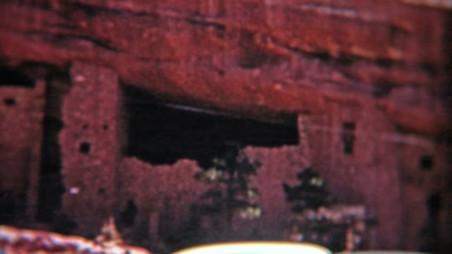 MESA VERDE, COLORADO 1955: Cars parked super close to ancient native american house. video