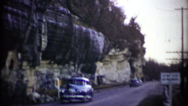 (1950s 8mm Vintage) Cars Passing By Cliff video