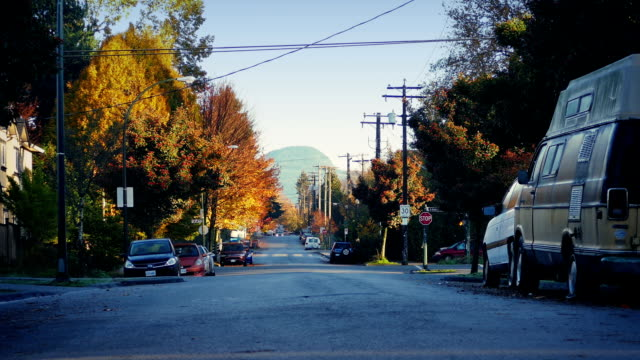 Cars Passing Through Pretty Suburbs At Sunrise Dolly shot passing roads in suburban area in the morning vancouver canada stock videos & royalty-free footage