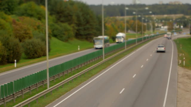 Cars running on highway down street. Four lanes two direction. Vilnius transport traffic video