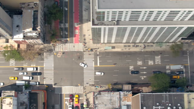 AERIAL: Cars, semi trucks and yellow taxis on busy New York City local streets video