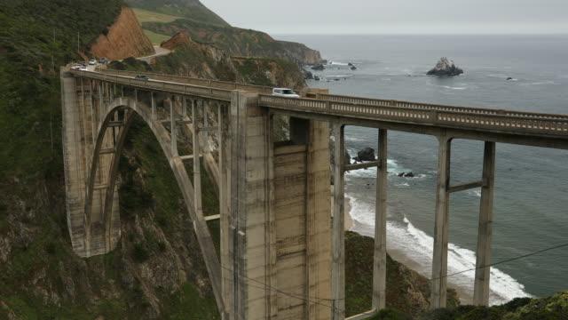 Cars travel down the Bixby Bridge, Big Sur, California, USA video