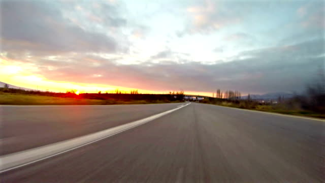 Cars traveling on rural road toward sunset, uhd 4k shot Cars traveling on rural road toward sunset, uhd 4k shot sports car stock videos & royalty-free footage