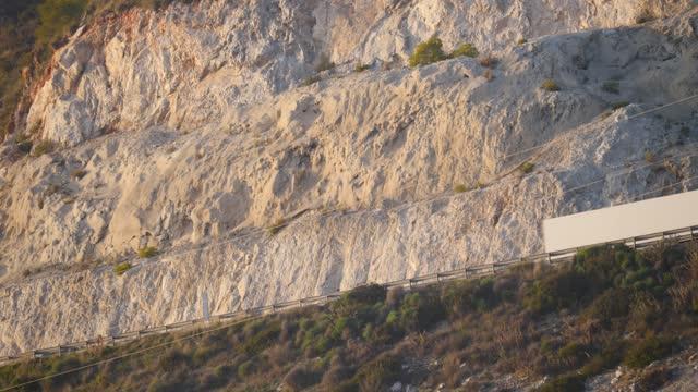Cars trucks on mountain road in Spain video