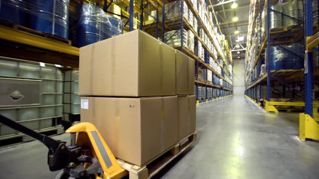 Cart with merchandise moving in warehouse Close-up of cart with merchandise moving in warehouse forklift stock videos & royalty-free footage