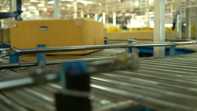 Carton box moving on conveyor rollers. video