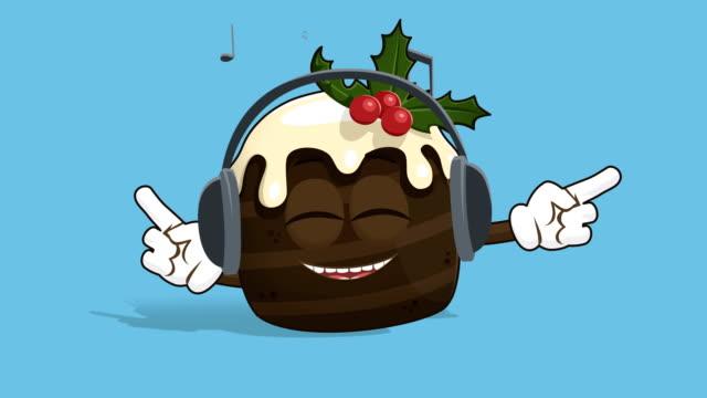 vídeos de stock e filmes b-roll de cartoon christmas cake listen music with face animation alpha matte - christmas cake