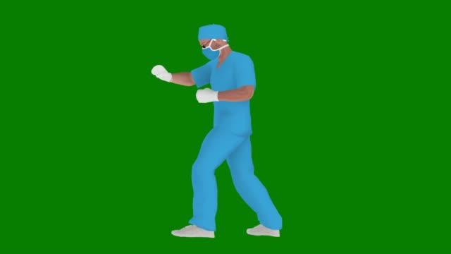 マスクを使用して漫画ドクターは、グリーンスクリーン上のコロナウイルスをパンチしています (covid-19, 2019-ncov) または何か他のアニメーション - 拳 イラスト点の映像素材/bロール