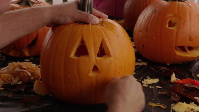 Carving jack o lantern pumpkin for Halloween
