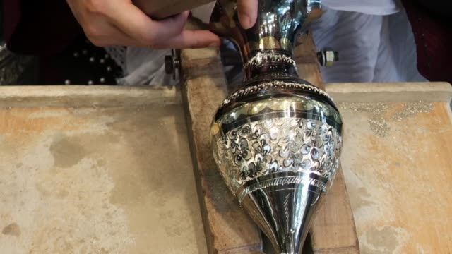 Carving metal vases with traditional Iranian patterns video