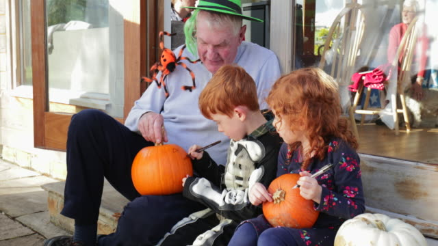 carving pumpkins with grandpa - halloween stock videos & royalty-free footage