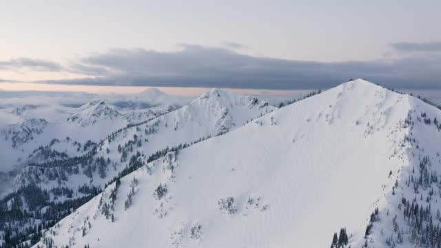 Cascade Mountain Range Snowy Winter Mountain Aerial Drone View Multiple Summit Peaks Near Mt Rainier Mount Baker