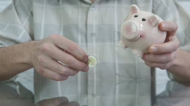 cash for piggy bank. - nazionalità russa video stock e b–roll