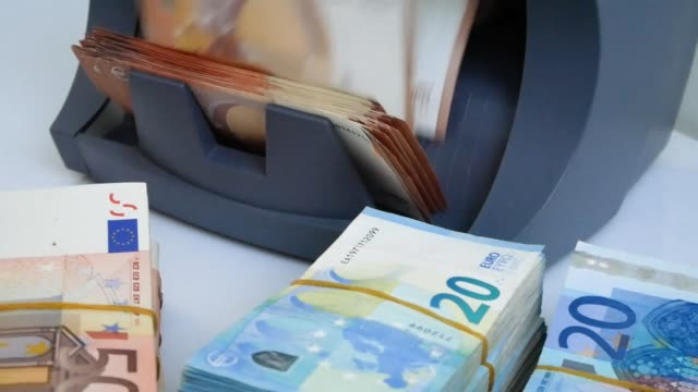 cash money counter and detector of banknotes for the count of notes and determination of fake 50 and 20 euro cash money counter and detector of banknotes for the count of notes and determination of fake money counts 50 and 20 euro close up bank counter stock videos & royalty-free footage