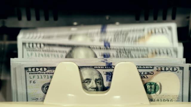 Cash money. Dollar bills counter.