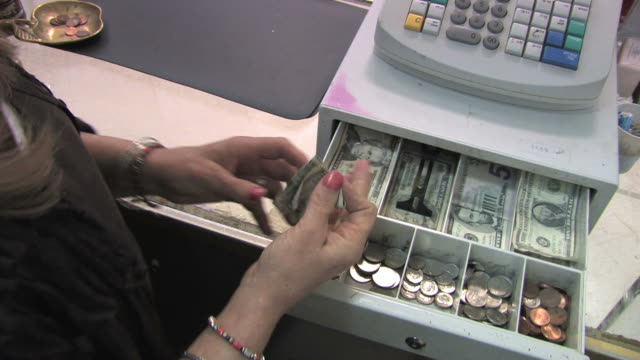 Cash Register in Action Clerk in a retail store makes change for a customer. American currency. Locked down, shot with Canon XH A1. register stock videos & royalty-free footage