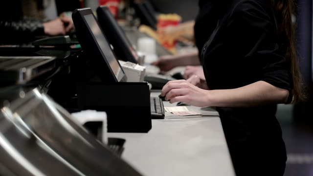 cash register in the shop. employees and buyers - junk food stock videos and b-roll footage