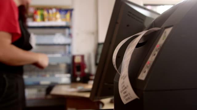 Cash register prints out check video